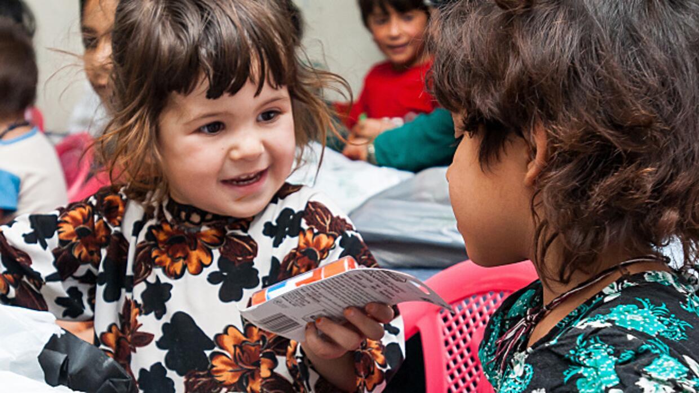 Kids sharing at school.