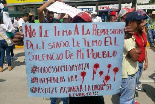 Los manifestantes exigían que las autoridades mexicanas, tanto federales...