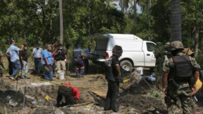 Autoridades encontraron los restos de los niños sepultados en una fosa d...