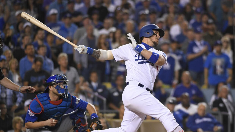Yasmani Grandal produjo tres carreras para los Dodgers.
