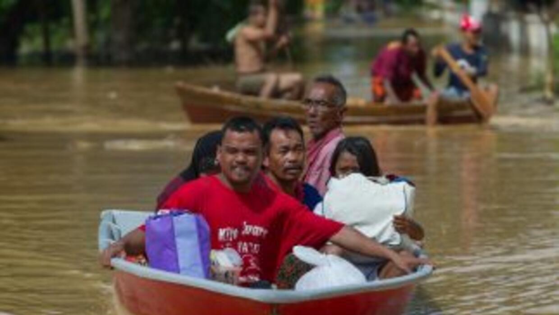 Al menos 119 mil personas han sido evacuadas por las inundaciones al nor...