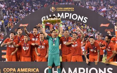 Chile's captain Claudio Bravo lifts the Copa America Centenario trophy i...