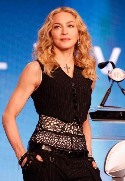 Madonna es otro ícono del cabello rizado. Al igual que Fergie &ie...