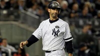 El bajo rendimiento de Jorge Posada llevó al manejador de los Yankees a...