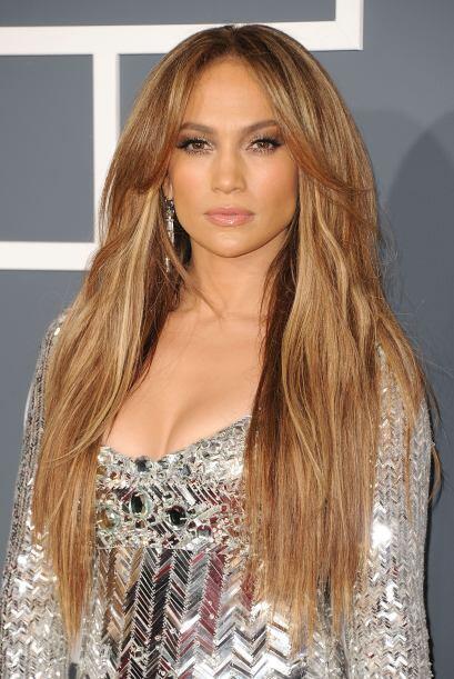 Sin duda uno de sus peinados más provocadores es el cabello lacio, que h...