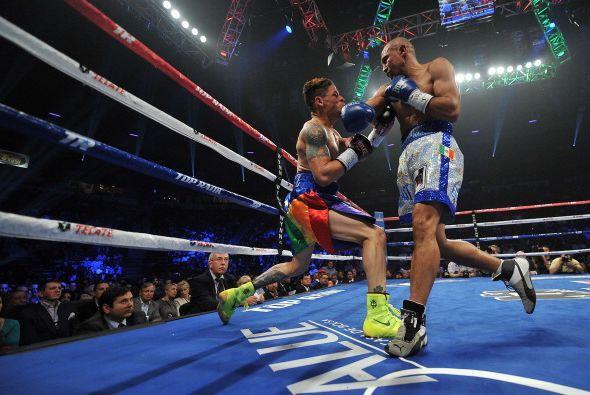 Buena pelea ofrecieron Orlando Cruz, quien intentó imponer su vel...