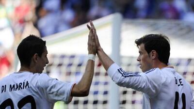 Gareth Bale celebra su gol con Di María.