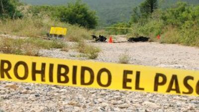 Los cuerpos mutilados de cinco hombres fueron encontrados el domingo en...