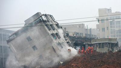 Hombre sobrevivió 60 horas tras deslave en China desastre5.jpg