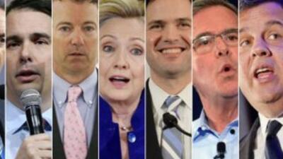 De izquierda a derecha los precandidatos presidenciales Mike Huckabee, S...