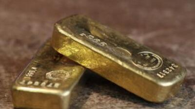 El oro gana 0.20% por la especulación de que el misil que derribó el avi...
