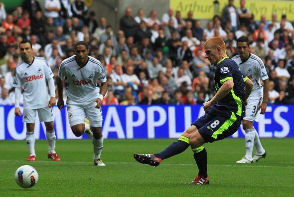 El ascendido Swansea City jugó de local ante el Wigan.