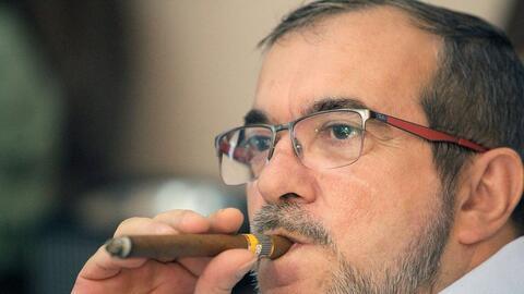 El lider de las FARC, Timoleon Jimenez 'Timochenko' observa por televisi...