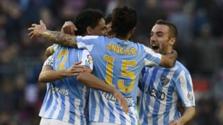 Dardier (Derecha) marcó el gol del triunfo del Málaga.