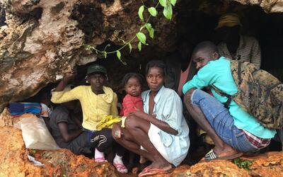 Some 240 Haitians, mostly women and children, took refuge in caves near...
