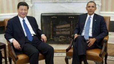 Barack Obama se reunió con el vicepresidente chino Xi Jinping en la Casa...