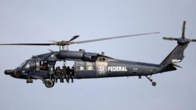Desde el aire policías federales descubrieron al grupo armado y con arti...