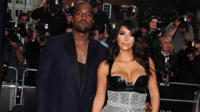 Kim Kardashian y Kanye West en los GQ Awards