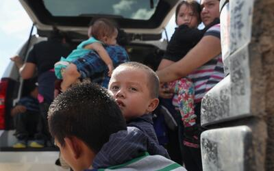 Immigrants from Central America wait to be taken into custody by U.S. Bo...