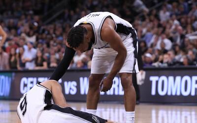 SAN ANTONIO, TX - MAY 03: Patty Mills #8 of the San Antonio Spurs checks...