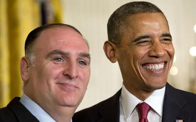 President Barack Obama smiles with chef Jose Andres, after awarding the...