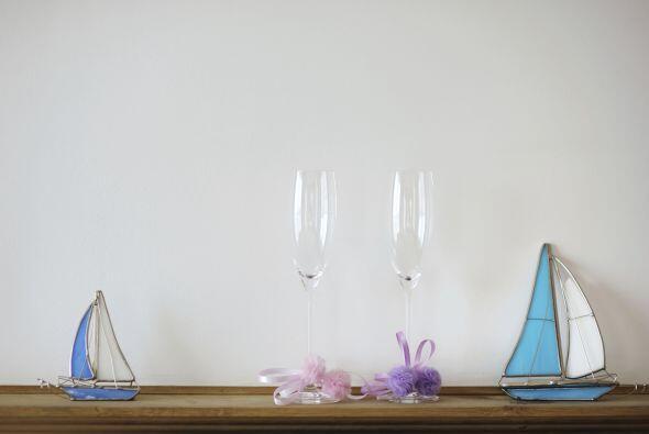 Para tus centros de mesa o recuerdos evoca motivos marinos como botes, t...