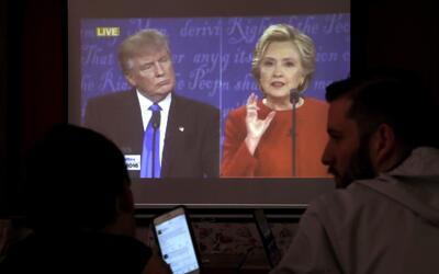 Donald Trump y Hillary Clinton durante el primer debate presidencial en...