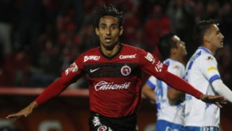 Fernando Arce marcó el último gol en el triunfo de Xolos sobre Puebla.