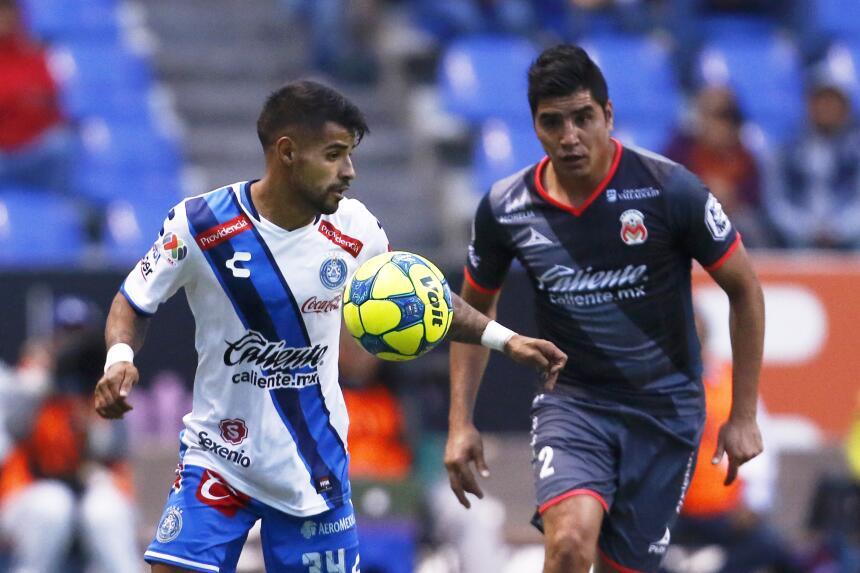 Morelia derrotó a Puebla con gol de último minuto Cristian Esparza y Enr...