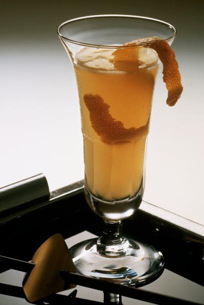 Naranja Cioccolato  1 1/4 de onza de vodka de naranja 1 onza de oz Melet...