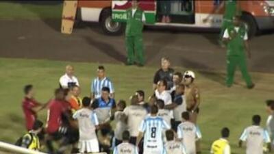 Integrantes de los equipos de los equipos de Londrina y Brasil de Pelota...