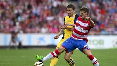 Granada y Atlético empataron un partido que les ayuda a cumplir objetivos.