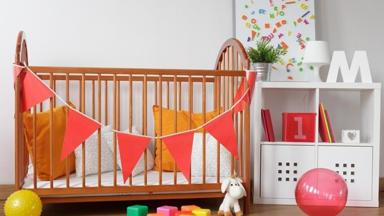 Picture of contemporary wooden furniture in babygirl room