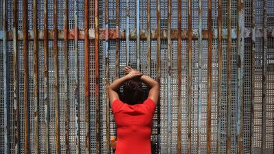 In photos: Border encounters at the fence dividing the United States and Mexico