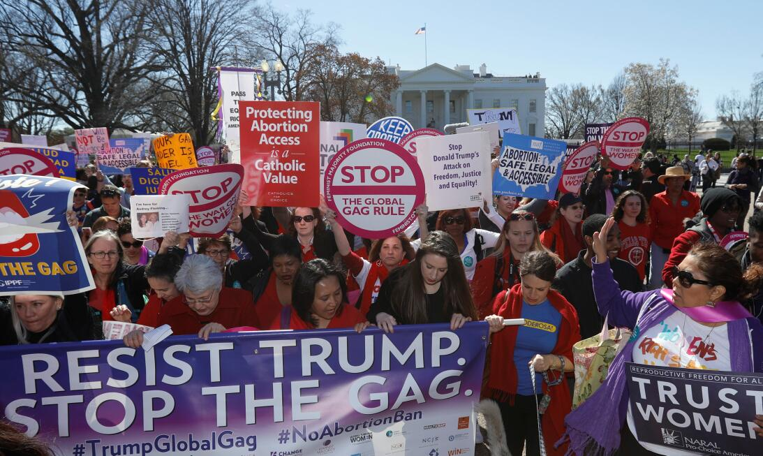 """Activists march past the White House as part of """"A Day Without a Wo..."""