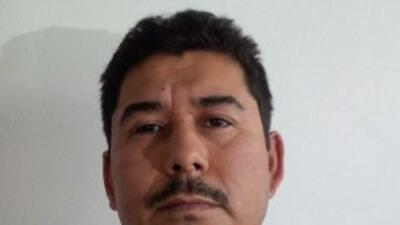 Foto de Carlos Manuel Hoo Ramírez detenido junto a Joaquín Guzmán Loera.