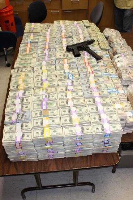 Police recovered at least $24 million, as well as a Tec-9 pistol.