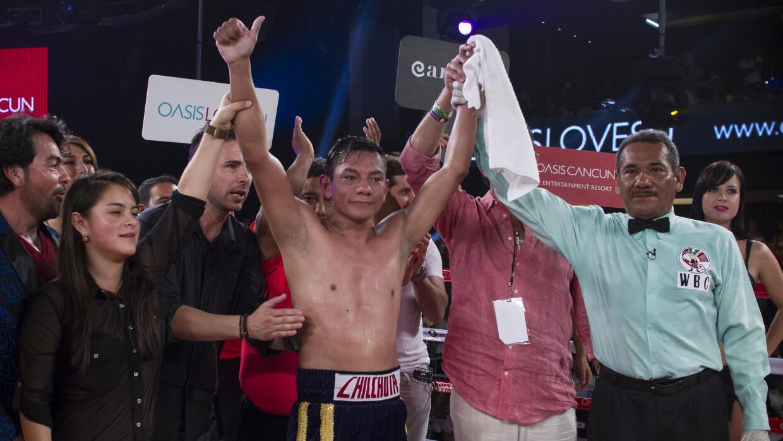 Cristian Mijares sufrió para vencer a Vergel Nebran 20140621_8134.jpg