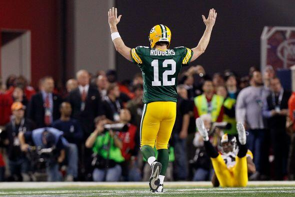 Rodgers, quien tiene el segundo mejor rating de pasador en la NFL con 11...