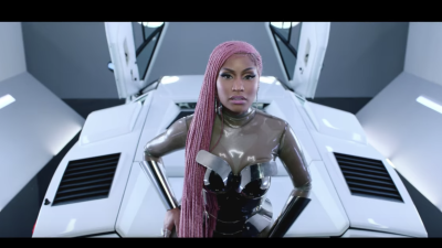 Rapper Nicki Minaj raps in the music video for Migos' 'MotorSport.' Card...