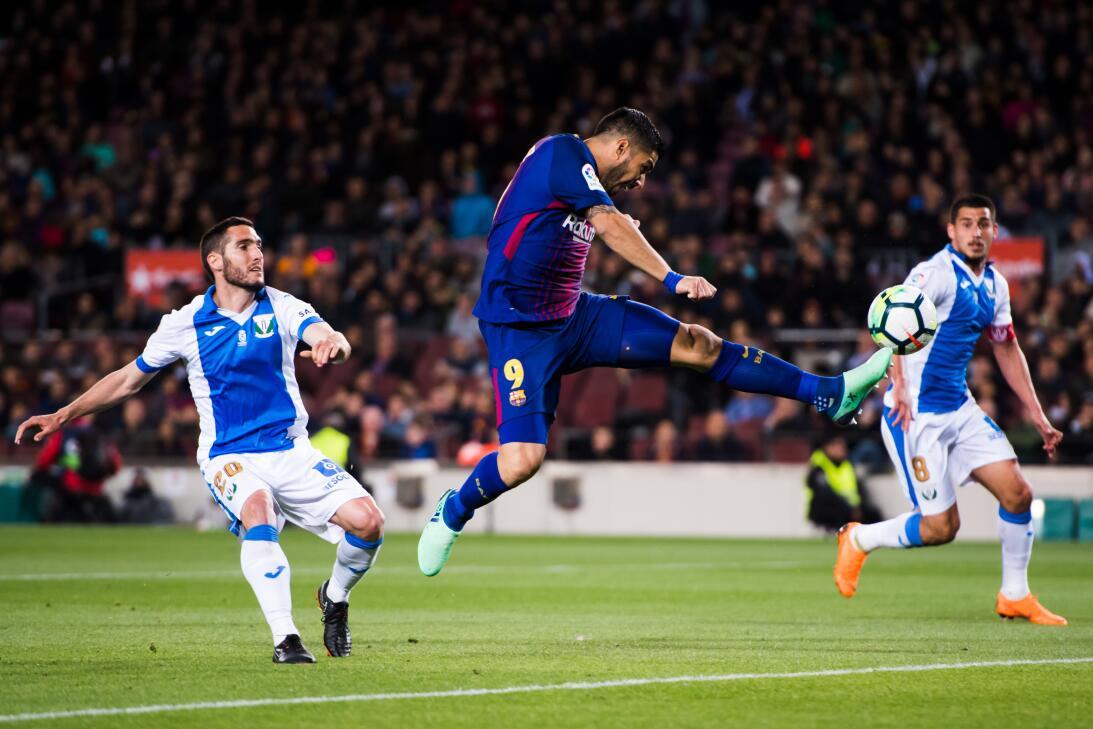 En fotos: Barcelona de récord con triplete de Messi gettyimages-94311134...