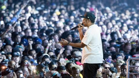 Rapper Jay-Z looks out to the crowd during his headlining performance at...