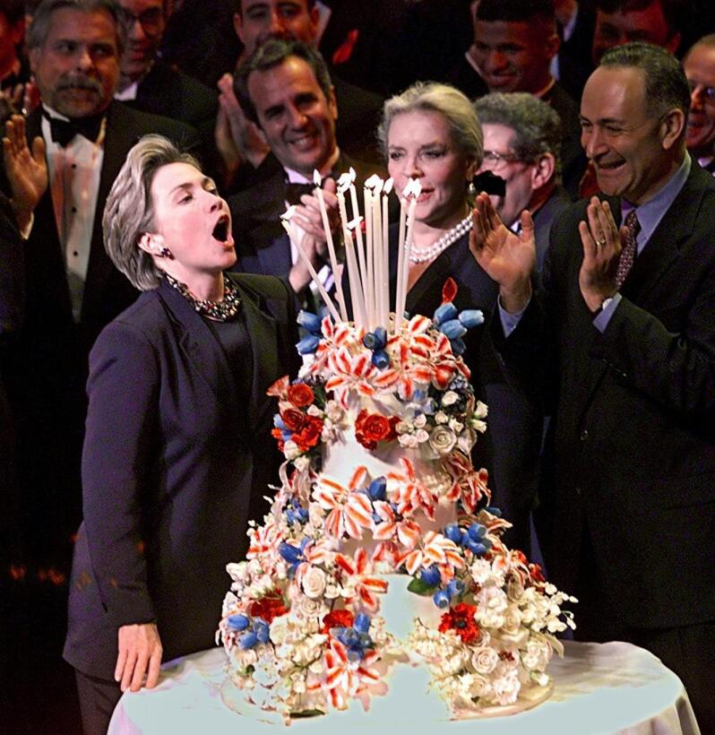 US First Lady Hillary Rodham Clinton (L) celebrates her 52nd birthday by...