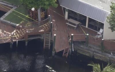 Miembros de una familia caen a un lago al colapsar muelle