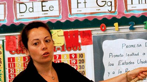 Lourdes Carmona, a Spanish speaking first grade teacher, instructs a cla...