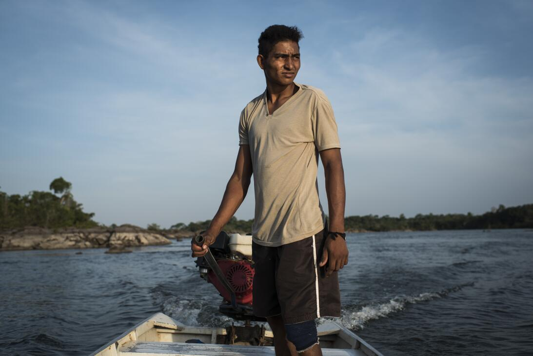 Henriques P. Morois, 20, heads out to fish on the Xingu River. Fishing h...