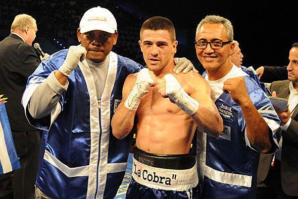 Dj, preparador físico, Angelo Santana y Jorge Rubio,entrenador.