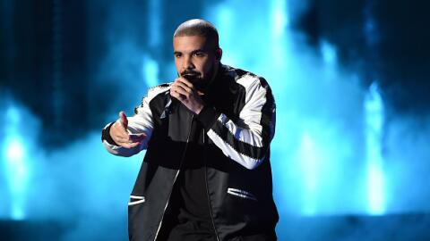 Drake raps onstage at the iHeartRadio Music Festival at T-Mobile Arena i...