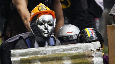 In photos: Masked for battle, Venezuelan protesters find ingenious ways to protect themselves