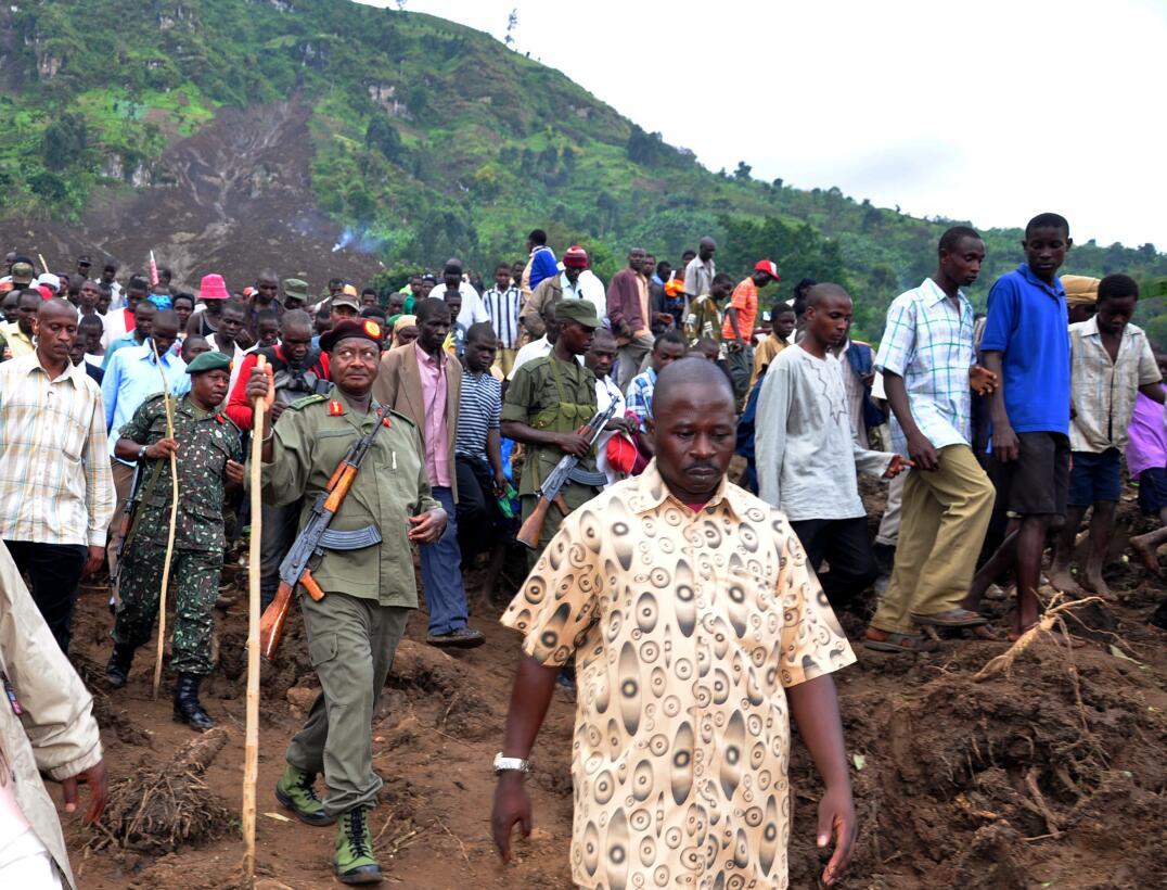 Ugandan president Yoweri Museveni (3rd L with uniform) tours on March 3,...